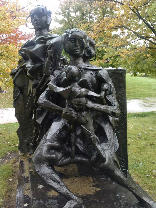 Sculpture of a family on campus